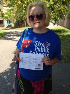 Teacher Penny Culliton with her ticket to the 74's Education Summit.